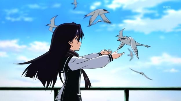 Kuroki Rei hugging a bird
